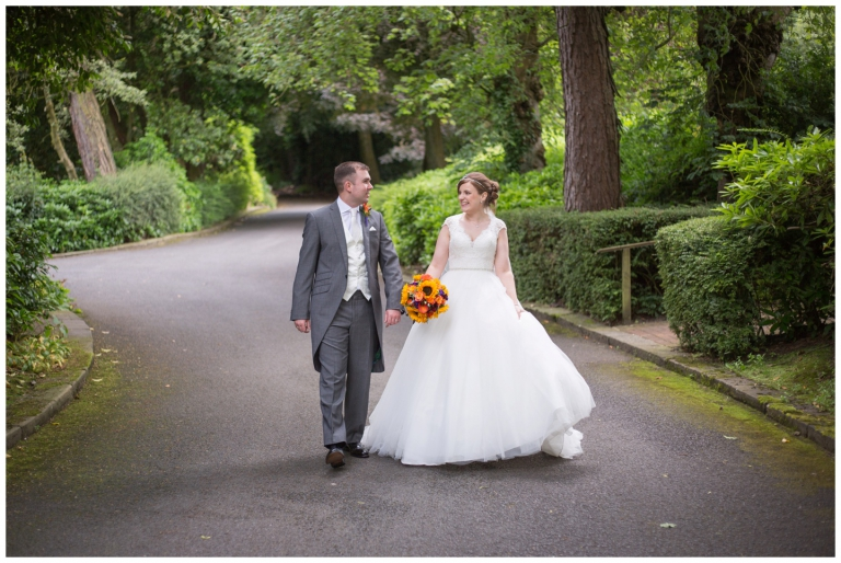 Lancashire-Wedding-Photographer-2015-in-pictures, happy couple walking down the lane in wedding attire