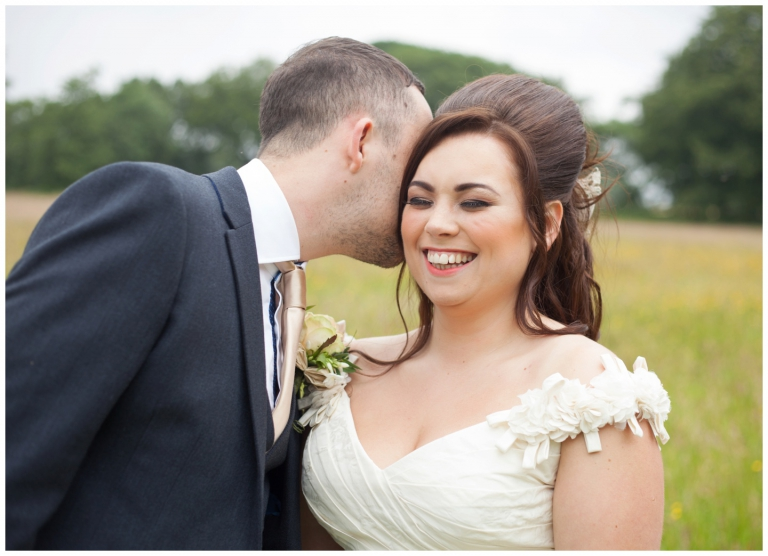 bride and groom whispering and laughing, natural wedding photography in lancashire