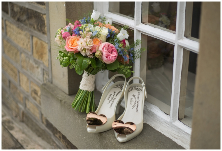 vivienne westwood shoes and bridal bouquet on the window sill of the new hobbit pub in halifax